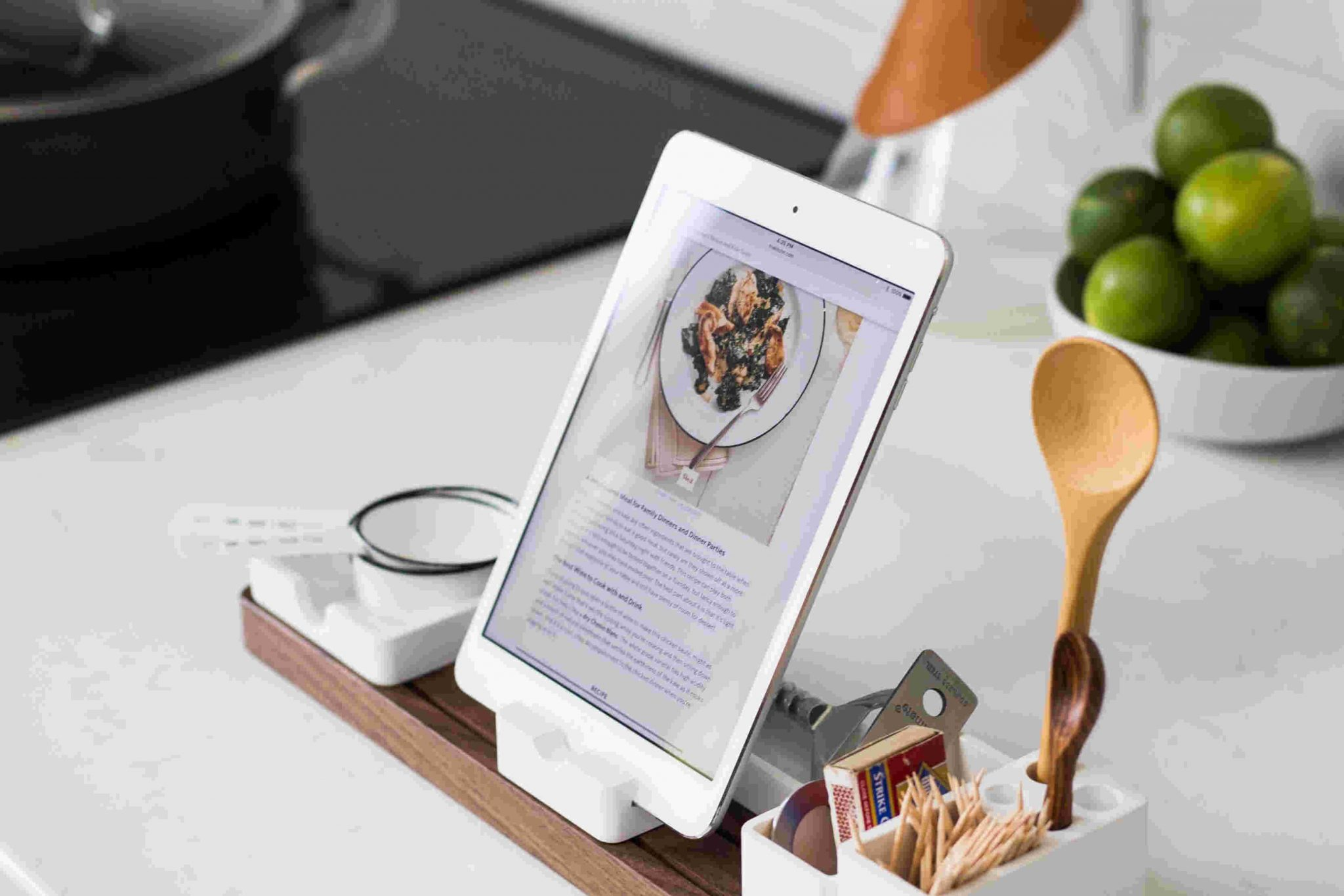 kitchen counter with a tablet showing a recipe